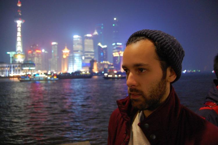 boy shanghai fun lights bund neon skyscrapers pudong sea